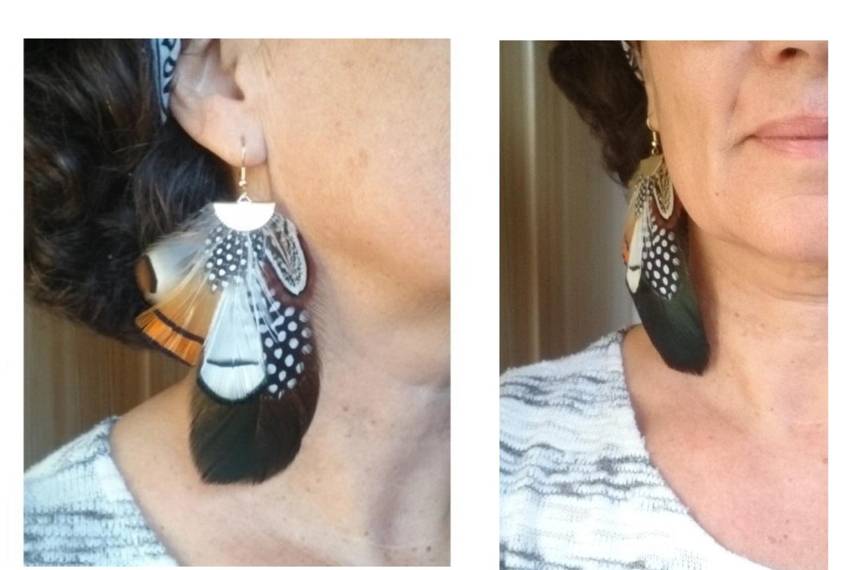 grandes boucles d'oreilles avec de nombreuses plumes, photo portée. plumes oranges, blanches et noires avec des graphismes